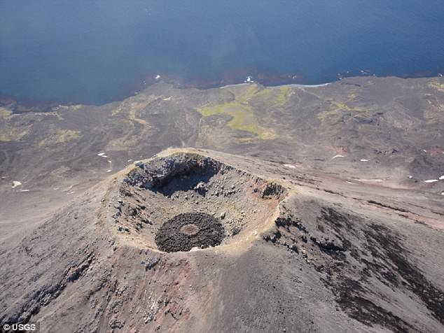 The lava acts like a cap on Cleveland's vent, and this week's activity suggests a good chance of a powerful explosion to blow off that cap, he said. This file photo shows the formation of a cap (darker rock) within Mount Cleveland's crater