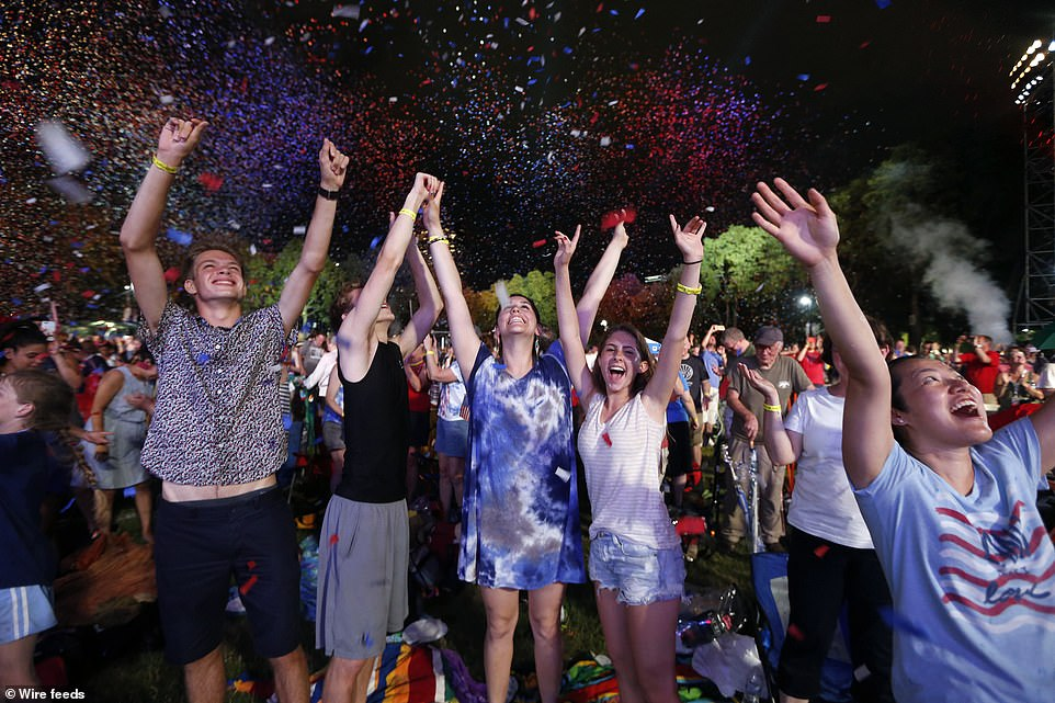 Spectators cheered as confetti falls during rehearsal for the Boston Pops Fireworks Spectacular in Boston