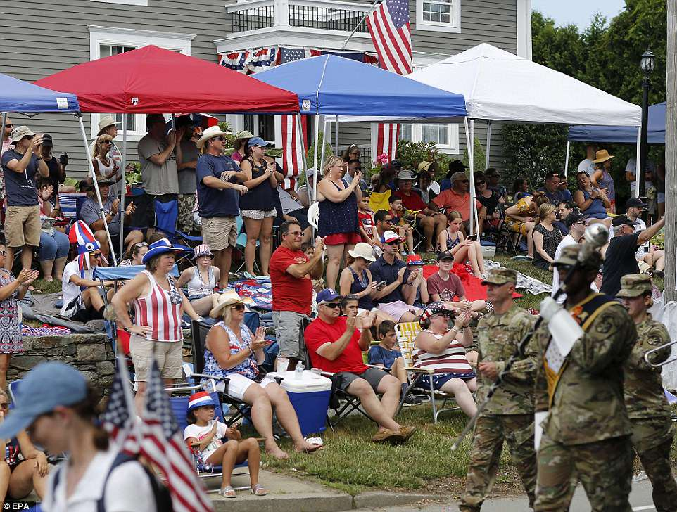 Residents cheer on the 233rd Bristol 4th of July Celebration in Rhode island on Wednesday