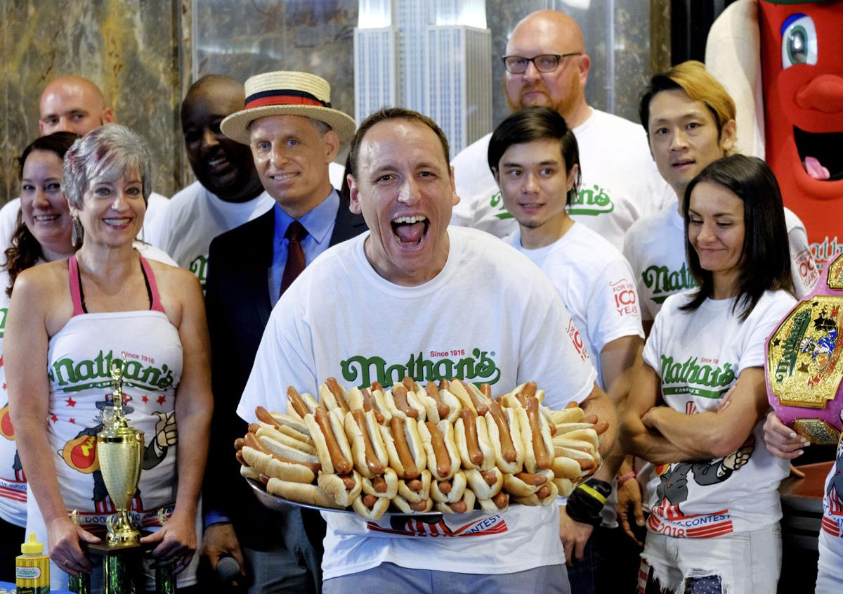 Kết quả hình ảnh cho Hot dog eating machine Joey Chestnut sets record with 74 weiners in 10 minutes