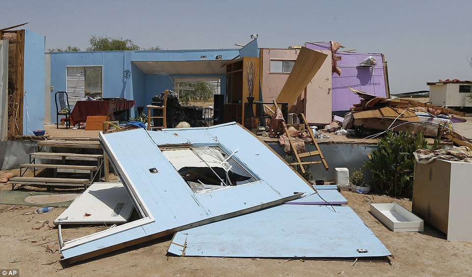 A mobile home was among those destroyed by a monsoon storm on Monday in Buckeye, Arizona. The storm packed thunder and lightning, high winds and sheets of rain as it caused flights to be grounded and damaged property