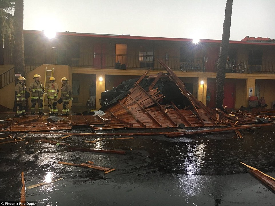 High winds blew off part of the roof of a Phoenix apartment onto the tops of some cars parked outside