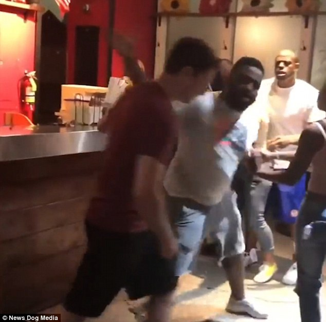 In the shocking clip, filmed at Hot Taco Restaurant in Detroit, Michigan, the man in the red shirt cuts in line before being attacked by another customer