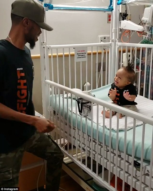 Celebration: Kenny Thomas, 34, of Merchantville, New Jersey, performed an epic dance next to his son's hospital bed after the one-year-old recovered from his first round of chemotherapy