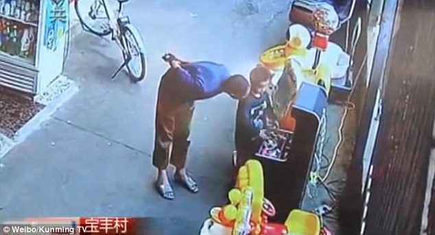 A stranger then approaches him and starts to talk to the young boy, as a CCTV video shows
