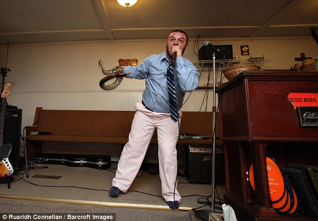 Cody Coots (pictured) is the pastor at the Full Gospel Tabernacle in Jesus¿ Name church in Middlesboro, Kentucky - one of America¿s last remaining snake-handling churches