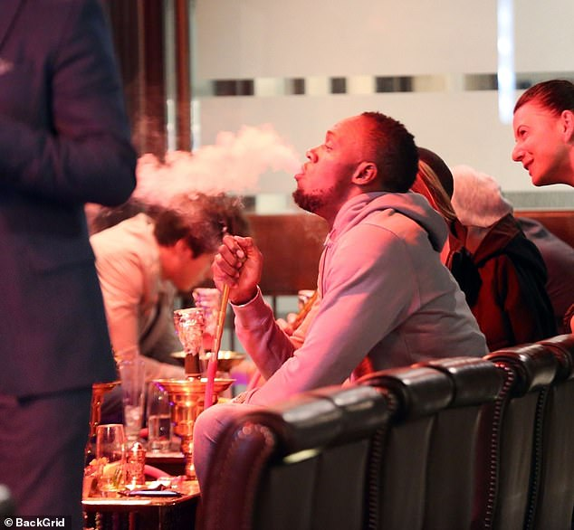 Smoking shisha (pictured, world champion sprinter Usain Bolt in October) could be as bad or worse than an entire packet of cigarettes despite its reputation for being healthier, experts say