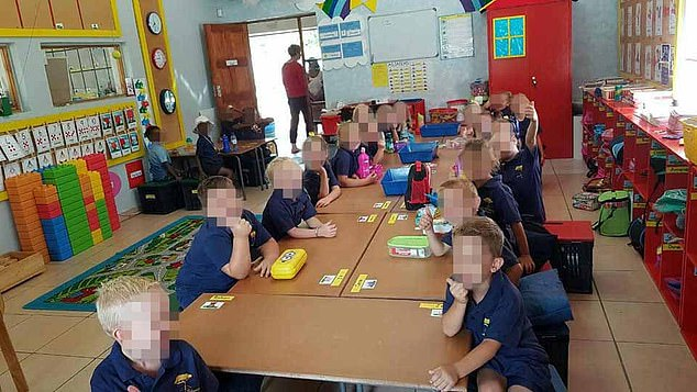 Black and white children were seen sitting at separate tables at Laerskool Schweizer-Reneke kindergarten in South Africa in an image taken by the class teacher