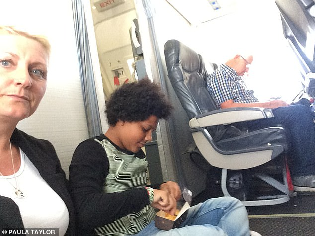 Paula Taylor, with her daughter Brooke, was forced to sit on the flor on their two-hour flight to Menorca