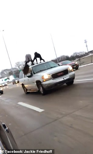 They gyrate and scream while clinging onto the off-white SUV