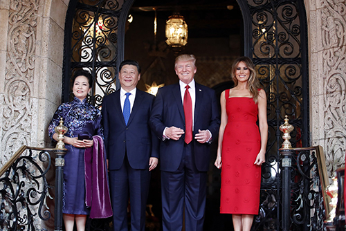 President Donald Trump and Chinese President Xi Jinping, with their wives, first lady Melania Trump and Chinese first lady Peng Liyuan, pose for photographers before dinner at Mar-a-Lago, on April 6, 2017, in Palm Beach, Florida.Alex Brandon / AP file