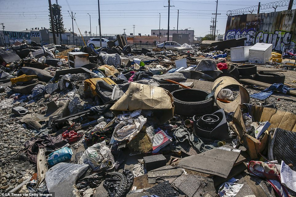 Piles of trash remain near the intersection of 25th St. and Long Beach Ave.Images from the downtown area show trash piling up as workers struggle to keep the area sanitized. They are pictured wearing face masks among the dirt and grime