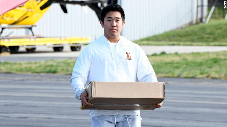 TJ is caries essentiel supplies to his plane. He hopes to attend the US Naval Academy after high school.