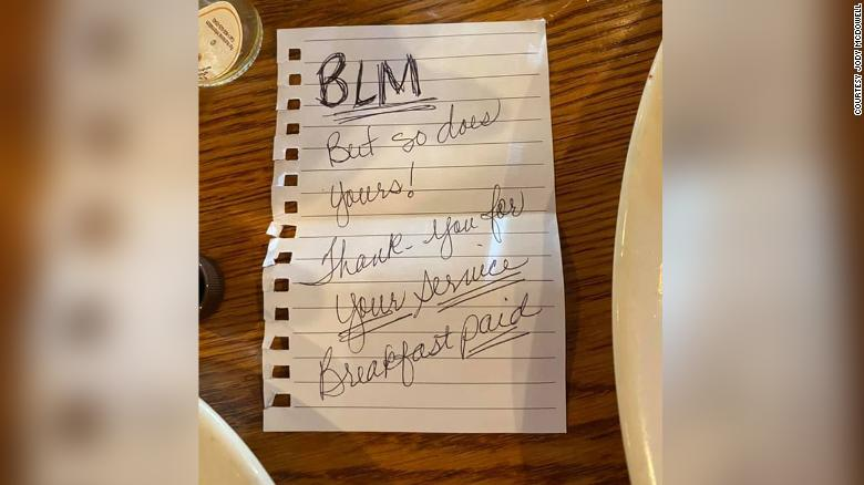 Two black women wrote the note above after anonymously paying for a sheriff's deputy's meal at a Nashville restaurant.
