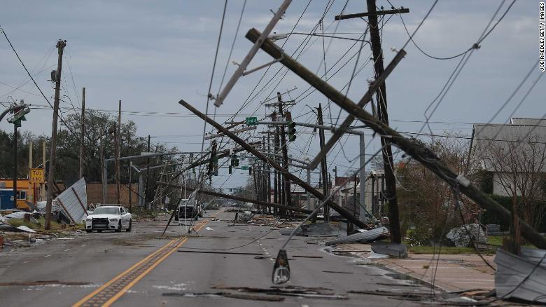 Downed power lines and debris litter a street in Lake Charles on Thursday morning after Hurricane Laura tore through the area.