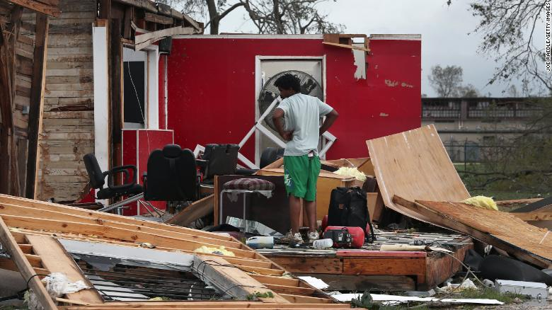 A man surveys what is left of his uncle's barber shop in Lake Charles.