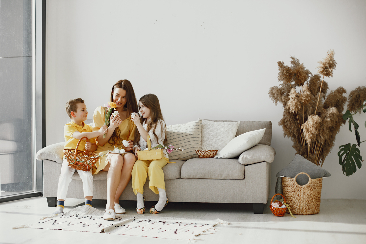 mother with daughter son home make up holiday basket festive clothes